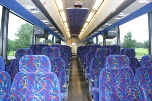 Comfortable Seating (56 passenger coach shown) with an On-Board Rest Room.
